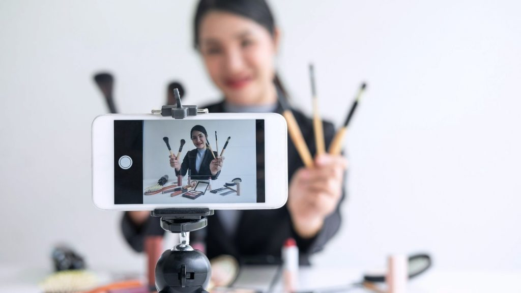 Photo of a women producing her own live video on a mobile phone